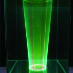 Title: Programmable laser animation - 2011 - 200x52x52cm - glass, liquid, laser light, painted wood, sound
