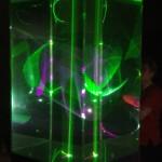 Title: Programmable laser animation - 2011 - 200x52x52cm - glass, liquid, laser light, painted wood, sound