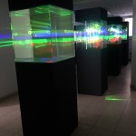 Title: Travelling of light, programmable laser installation - 2012 - 1600x1200x200cm - glass, painted wood, aluminum, PVC, mirror